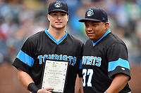 Asheville Tourists designated hitter Casey Golden (11) poses with manager Robinson Cancel (37) after accepting the South Atlantic League Player of the Week award before a game against the Rome Braves at McCormick Field on September 2, 2018 in Asheville, North Carolina. The Braves defeated the Tourists 2-1. (Tony Farlow/Four Seam Images)