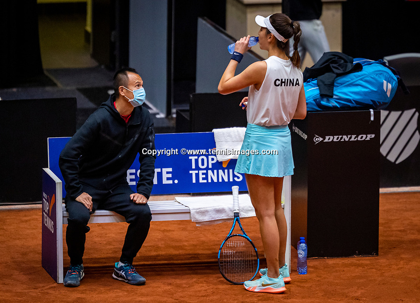 Den Bosch, The Netherlands, April 16, 2021,    Maaspoort, Billy Jean King Cup  Netherlands -  China :  Chinese bench with captaiin  Shuo Liu and Xinyu Wang (CHN)<br /> Photo: Tennisimages/Henk Koster