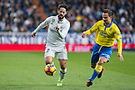 Isco Alarcon of Real Madrid competes for the ball with during the match of Spanish La Liga between Real Madrid and UD Las Palmas at  Santiago Bernabeu Stadium in Madrid, Spain. March 01, 2017. (ALTERPHOTOS / Rodrigo Jimenez)