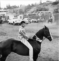 Tony Marchand sitting on his horse Skookum before the third Suicide Race of the Championship. He won this race and went on to finnish runner up in the overall competition. The Omak Suicide Race is part of the Omak Stampede, a rodeo which is held on the Colville Native American / Indian Reservation...