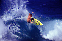 Surfer riding a wave off Rocky Point on the North Shore of Oahu