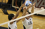 Nevada's Tessa Lea'ea, left, and Elissas Ji block against Seattle University during NCAA womens college volleyball in Reno, Nev., on Thursday, Oct. 20, 2011. Nevada won 3-0..Photo by Cathleen Allison