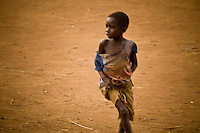 "Portait of  a child running in Nyori refugee camp in Congo. The LRA has been attacking villages in Congo since late 2008 and kidnapping children as young as 5 years old. the boys serve as porters or soldiers in training and the girls  are given to LRA soldiers as ""wives."""