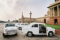 Ambassador cars transport members of the government outside the Secretariat buildings in Delhi.