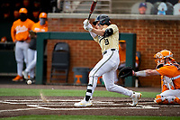 Vanderbilt Commodores shortstop Carter Young (9) at bat against the Tennessee Volunteers on Robert M. Lindsay Field at Lindsey Nelson Stadium on April 17, 2021, in Knoxville, Tennessee. (Danny Parker/Four Seam Images)