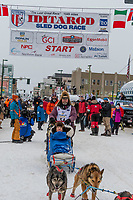 Robert Bundtzen and team leave the ceremonial start line with an Iditarider and handler at 4th Avenue and D street in downtown Anchorage, Alaska on Saturday March 7th during the 2020 Iditarod race. Photo copyright by Cathy Hart Photography.com