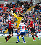 Goalkeeper Grace Maloney of Reading punches the ball away fro Manchester attack