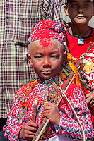 Nepal, Changu Narayan.  A Nine-year-old Hindu Boy Participating in his Bratabandha Ceremony Marking his Entry into Manhood.  His head has been sprinkled with red kumkuma powder.