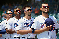 Jacksonville Jumbo Shrimp players, L-R, Robert Dugger (12), Stone Garrett (31), Cody Poteet (21), and Santiago Chavez (13) during the national anthem before a Southern League game against the Tennessee Smokies on April 29, 2019 at Baseball Grounds of Jacksonville in Jacksonville, Florida.  Tennessee defeated Jacksonville 4-1.  (Mike Janes/Four Seam Images)