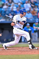 Asheville Tourists left fielder Sam Hilliard (25) swings at a pitch during a game against the Lexington Legends at McCormick Field on April 18, 2016 in Asheville, North Carolina. The Legends defeated the Tourists 7-5. (Tony Farlow/Four Seam Images)