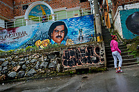 "A Colombian woman walks along a large mural artwork, depicting the drug lord Pablo Escobar, painted on the wall in the Pablo Escobar neighborhood in Medellín, Colombia, 30 November 2017. Twenty five years after Pablo Escobar's death, the legacy of the Medellín Cartel leader is alive and flourishing. Although many Colombians who lived through the decades of drug wars, assassinations, kidnappings, reject Pablo Escobar's cult and his celebrity status, there is a significant number of Colombians who admire him, worshipping the questionable ""Robin Hood"" image he had. Moreover, in the recent years, the popular ""Narcos"" TV series has inspired thousands of tourists to visit Medellín, creating a booming business for many but causing a controversial rise of narco-tourism."