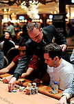 A Venetian poker room tournament staffer replaces the 10K chips with blue 25K chips.  Players have had a hard time distinguishing the $10K chips from some smaller denomination chips.
