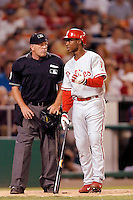 3 September 2005: Kenny Lofton, outfielder for the Philadelphia Phillies, discusses a call with home plate umpire Ed Montague during a game against the Washington Nationals. The Nationals defeated the Phillies 5-4 at RFK Stadium in Washington, DC. <br />