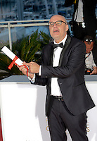 Spanish director Juanjo Gimenez poses with the Palme d'Or award for Best Short Film for 'Timecode' at the Palme D'Or Winner Photocall during the 69th annual Cannes Film Festival at the Palais des Festivals on May 22, 2016 in Cannes, France.