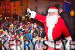 HoHoHo<br /> ---------<br /> Santa rings the bell to have the lights turned on the Christmas tree last Sunday evening at 6pm in the square,Killorglin with many adoring children looking on.