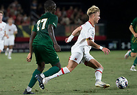 COLLEGE PARK, MD - SEPTEMBER 3: Maryland University forward Caden Stafford (10) dribbles past George Mason University defender Jonathan Fawole (27) during a game between George Mason University and University of Maryland at Ludwig Field on September 3, 2021 in College Park, Maryland.