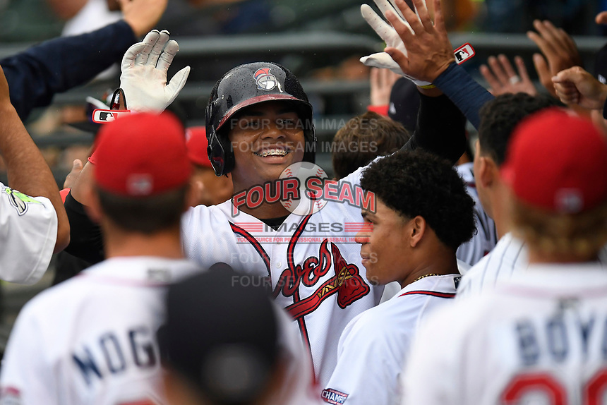 Cristian Pache (25) of the Rome Braves is greeted after scoring a run for the South team in the South Atlantic League All-Star Game on Tuesday, June 20, 2017, at Spirit Communications Park in Columbia, South Carolina. The game was suspended due to rain after seven innings tied, 3-3. (Tom Priddy/Four Seam Images)