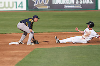 Beloit Snappers infielder Trent Gilbert (3) tags out Wisconsin Timber Rattlers third baseman Tucker Neuhaus (10) during a Midwest League game  on May 30th, 2015 at Fox Cities Stadium in Appleton, Wisconsin. Wisconsin defeated Beloit 5-3 in the completion of a game originally started on May 29th before being suspended by rain with the score tied 3-3 in the sixth inning. (Brad Krause/Four Seam Images)
