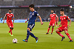 Kitagawa Koya of Japan (C) in action during the AFC Asian Cup UAE 2019 Group F match between Oman (OMA) and Japan (JPN) at Zayed Sports City Stadium on 13 January 2019 in Abu Dhabi, United Arab Emirates. Photo by Marcio Rodrigo Machado / Power Sport Images
