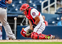 27 February 2019: Washington Nationals catcher Raudy Read makes a block during play against the Houston Astros at the Ballpark of the Palm Beaches in West Palm Beach, Florida. The Nationals defeated the Astros 14-8 in their Spring Training Grapefruit League matchup. Mandatory Credit: Ed Wolfstein Photo *** RAW (NEF) Image File Available ***