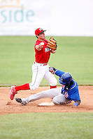 June 21, 2009:  Second Baseman Alan Ahmady of the Batavia Muckdogs turns a double play as Jonathan Fernandez of Auburn slides in during a game at Dwyer Stadium in Batavia, NY.  The Muckdogs are the NY-Penn League Short-Season Class-A affiliate of the St. Louis Cardinals.  Photo by:  Mike Janes/Four Seam Images