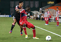 WASHINGTON, DC. - AUGUST 22, 2012:  Andy Najar (14) of DC United is blocked off the ball by  Patrick Nyarko (14) of the Chicago Fire during an MLS match at RFK Stadium, in Washington DC,  on August 22. United won 4-2.