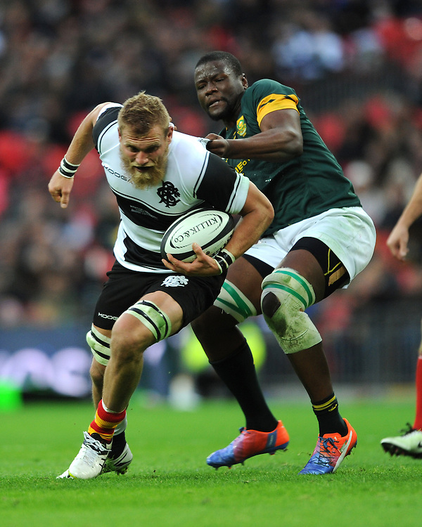 Brad Shields (Hurricanes) of Barbarians pushes his way through Teboho Mohoje of South Africa during the Killik Cup match between Barbarians and South Africa at Wembley Stadium on Saturday 5th November 2016 (Photo by Rob Munro)