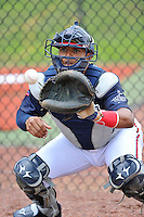 Catcher Carlos Martinez (8) of the Danville Braves warms up before in a game against the Johnson City Cardinals on Friday, July 1, 2016, at Legion Field at Dan Daniel Memorial Park in Danville, Virginia. Johnson City won, 1-0. (Tom Priddy/Four Seam Images)