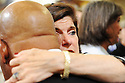 Lucie Baines Johsnon, daughter of President Lydon Johnson hugs US Rep. John Lewis at former US Rep. Lindy Boggs'  funeral at St. Louis Cathedral, New Orleans, Aug. 1, 2013.