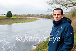 Cllr Jimmy Moloney stands on the bank of the river Feale where there are major improvement works ongoing