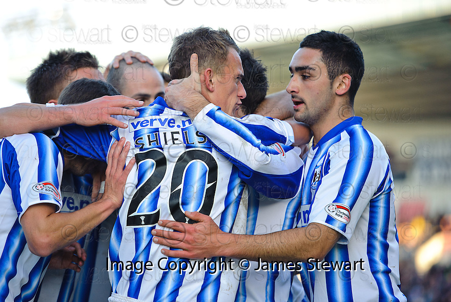 KILMARNOCK'S DEAN SHIELS IS CONGRATULATED  AFTER HE SCORES KILLIE'S FIRST.