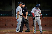 Jacksonville Jumbo Shrimp Jose Ceballos (30) argues a call with umpire Mark Stewart as Rodrigo Vigil (1) walks back to the dugout during a Southern League game against the Mobile BayBears on May 7, 2019 at Hank Aaron Stadium in Mobile, Alabama.  Mobile defeated Jacksonville 2-0.  (Mike Janes/Four Seam Images)