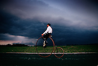 Bicycle enthusiast Don Stewart, dressed in 19th-century era clothing, pedals ahead of tornado warnings and an Indiana summer thunderstorm. When the road fell into decline, bicyclists banded together and demanded potholes be filled, which began a revival of the National Road.