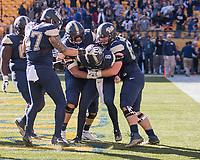 Pitt quarterback Kenny Pickett and teammates celebrate Pickett's 6-yard touchdown run.  The Pitt Panthers upset the undefeated Miami Hurricanes 24-14 on November 24, 2017 at Heinz Field, Pittsburgh, Pennsylvania.