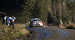 Rally fans bare their chests to Barry CLARK on the Resolven stage  of the Wales Rally GB in the forests of South Wales this afternoon..