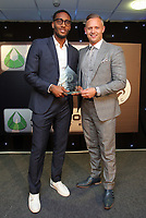 Pictured L-R: Leroy Fer receives an award by Lee Trundle Wednesday 18 May 2017<br /> Re: Swansea City FC, Player of the Year Awards at the Liberty Stadium, Wales, UK.