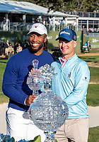 9th February 2020, Pebble Beach, Carmel, California, USA; Kevin Streelman and Larry Fitzgerald receive their Pro-Am trophy after the championship round of the AT&T Pro-Am on Sunday