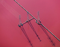 aerial photograph electrical power transmission towers in a salt pond, Newark, Alameda, California