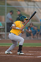 AZL Athletics shortstop Joseph Pena (5) follows through on his swing during an Arizona League game against the AZL Giants Black at the San Francisco Giants Training Complex on June 19, 2018 in Scottsdale, Arizona. AZL Athletics defeated AZL Giants Black 8-3. (Zachary Lucy/Four Seam Images)