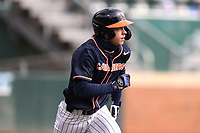 Nic Kent (4) of the Virginia Cavaliers hustles down the first base line against the North Carolina Tar Heels at Boshamer Stadium on February 27, 2021 in Chapel Hill, North Carolina. (Andy Mead/Four Seam Images)