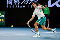 21st February 2021, Melbourne, Victoria, Australia; Novak Djokovic of Serbia returns the ball during the Men's Singles Final of the 2021 Australian Open on February 21 2021, at Melbourne Park in Melbourne, Australia.
