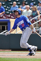 Josh Satin #13 of the Las Vegas 51s swings against the Omaha Storm Chasers at Werner Park on August 17, 2014 in Omaha, Nebraska. The Storm Chasers  won 4-0.   (Dennis Hubbard/Four Seam Images)