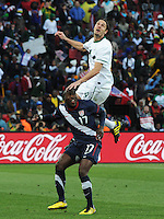 SLovenian defender Marko Suler goes over the back of U.S. forward Jozy Altidore contesting a header. The United States came from a 2-0 halftime deficit to Slovenia to earn draw their second match of play in Group C of the 2010 FIFA World Cup.