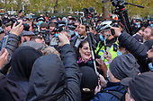 Police make arrests at Speakers' Corner after declaring a health incident due to overcrowding and failure to follow Covid-19 guidelines.  The unusually large crowd included clashes between supporters of Tommy Robinson and their opponents.  Hyde Park, London.