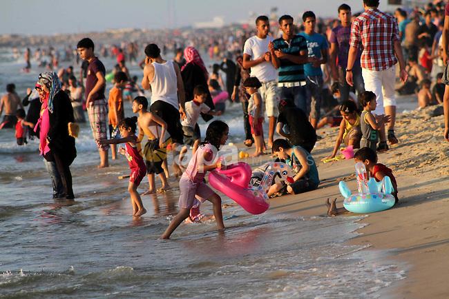Palestinians enjoy swimming on their week-end in the Mediterranean sea in Gaza City on July 06, 2012. Photo by Ashraf Amra