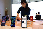 October 23, 2020, Tokyo, Japan - An employee of Apple checks an iPhone 12 an Apple store in Tokyo on Friday, October 23, 2020. iPhone 12 and iPhone 12 Pro started to sell here while iPhone 12 Pro Max and iPhone 12 mini will go on sale next month.        (Photo by Yoshio Tsunoda/AFLO)