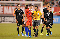 EAST RUTHERFORD, NJ - SEPTEMBER 7: Christian Pulisic #10 of the United States with Referee Joel Aguilar during a game between Mexico and USMNT at MetLife Stadium on September 6, 2019 in East Rutherford, New Jersey.