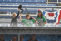 Young Batavia Muckdogs fans dance in the rain during a game against the West Virginia Black Bears on June 25, 2017 at Dwyer Stadium in Batavia, New York.  Batavia defeated West Virginia 4-1 in nine innings of a scheduled seven inning game.  (Mike Janes/Four Seam Images)