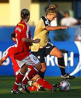 Amber Brooks gets through the Germany defence..FIFA U17 Women's World Cup, Semi Final, Germany v USA, QEII Stadium, Christchurch, New Zealand, Thursday 13 November 2008. Photo: Renee McKay/PHOTOSPORT