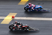 Jul. 20, 2014; Morrison, CO, USA; NHRA pro stock motorcycle rider Andrew Hines (near lane) races alongside Angie Smith during the Mile High Nationals at Bandimere Speedway. Mandatory Credit: Mark J. Rebilas-